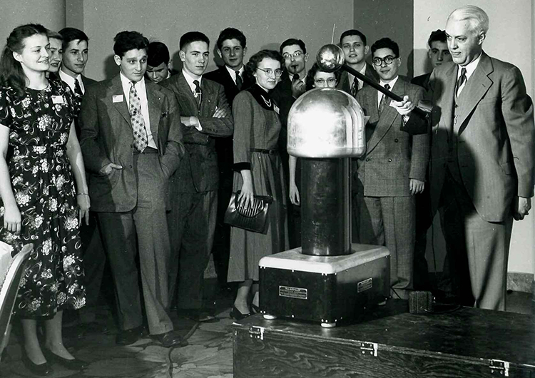 Dr. Richard Hitchcock of Westinghouse introduced 'junior,' the portable Van de Graaff generator to STS 1949 finalists.