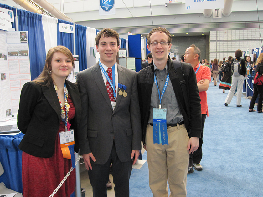 In 2012, judge and alumnus Scott Duke Kominers (right) poses with Intel ISEF alumni Sara Volz (left) and Jonah Kallenbach (middle).