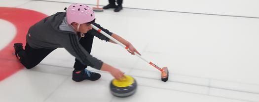 Dennis tried curling for the first time in Stockholm.