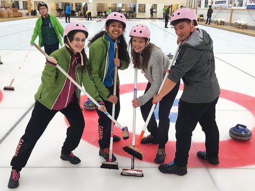 Dennis (right) went curling with the other young scientists.