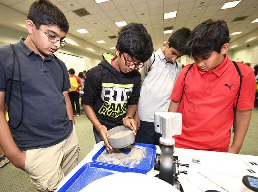 One of the STEM experiences at Intel ISEF 2017's Education Outreach Day focused on Mars rovers and how they take soil samples.