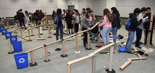 Students from local schools are bussed to the convention center for a unique STEM experience at Education Outreach Day. At Intel ISEF 2017, students built the ultimate recycling machine.