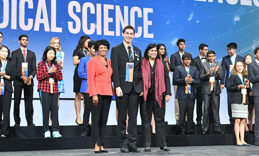 Jeremiah Pate (center) on stage at Intel ISEF 2017 with Society for Science & the Public President & CEO Maya Ajmera (right) and President of the Intel Foundation Rosalind Hudnell (left).