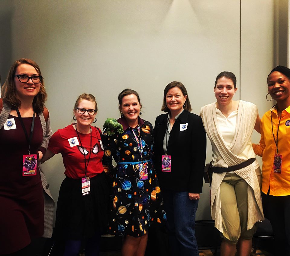 Panelists and attendees dressed up as Ms. Frizzle from <em>The Magic School Bus,</em> Rey from <em>Star Wars,</em> and Spiderwoman.