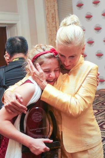 Broadcom Foundation President Paula Golden gives top winner Eleanor Sigrest congratulations and a big hug.