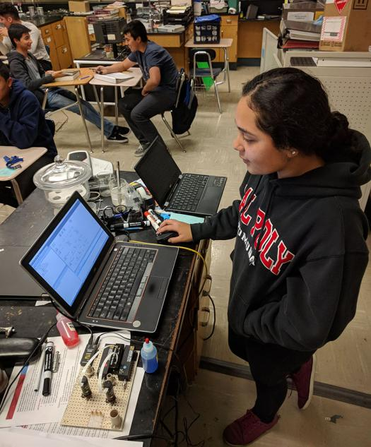 Lizbeth Martinez-Ramos works on a bio-microfluidic project at 7 a.m. She is learning how to write computer scripts.