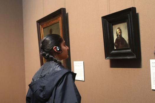 After learning about art conservation at the Getty Institute, Ashini Modi, from the U.S., examines a Rembrandt painting.