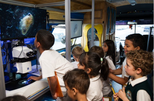 Students enjoy working with a microscope on the BioBus.