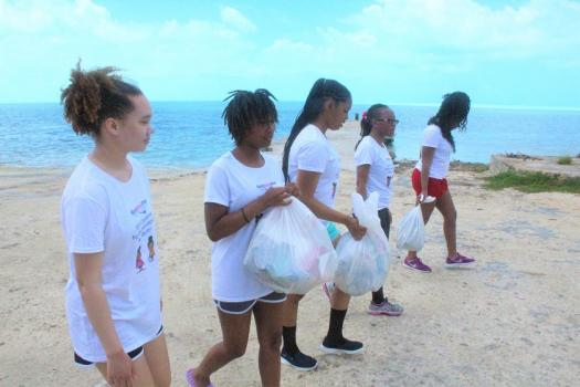 Black Girls Dive take part in ocean conservation efforts with a clean-up.
