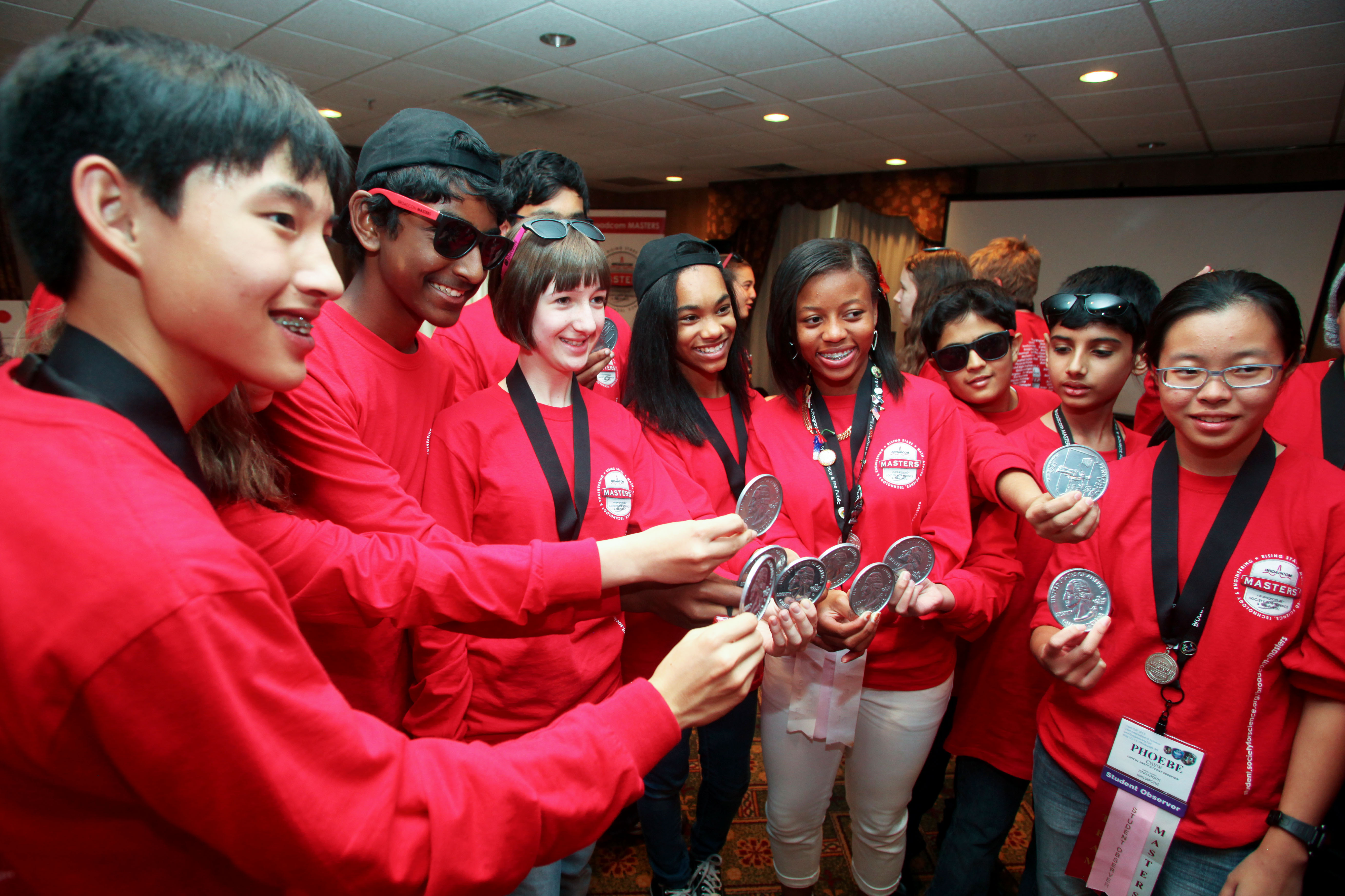 Delegates show off their medals at the 2015 Broadcom MASTERS International.