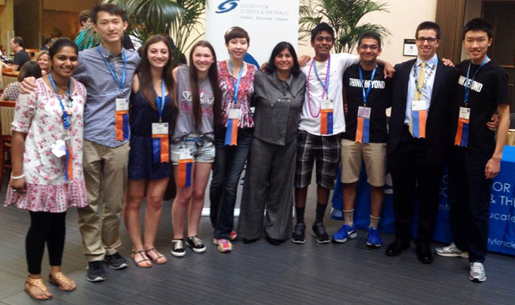 Maya Ajmera with Intel STS 2016 finalists during Intel ISEF 2016. PHOTOS COURTESY OF SOCIETY FOR SCIENCE & THE PUBLIC.