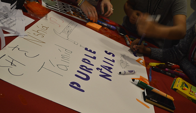 Members of the purple team designed their poster with their native languages saying