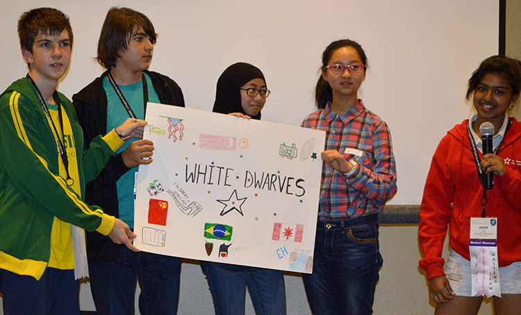 The white team described their poster at orientation.