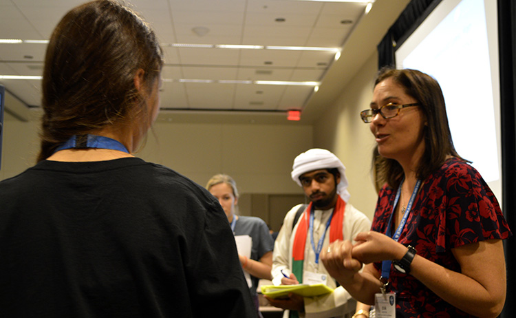 Eva offered tips while finalists described their research.