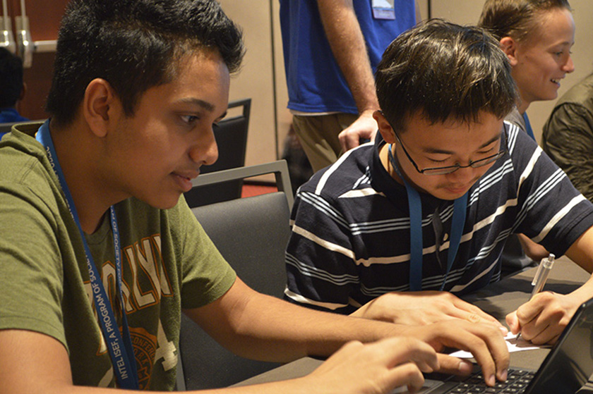 Student Observers try to beat video games in one of the workshops.