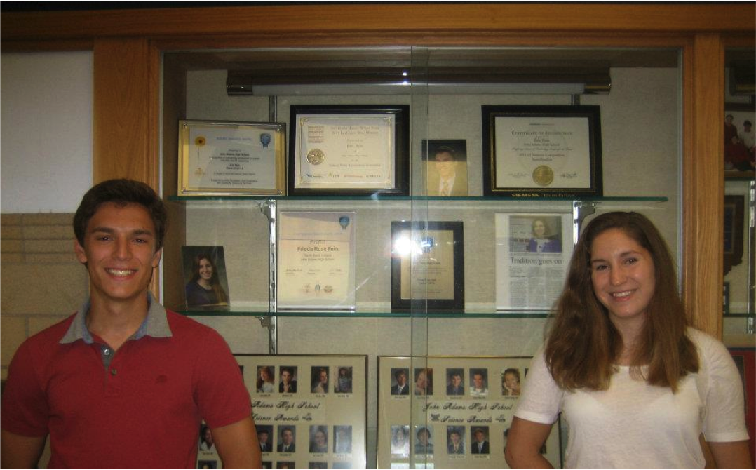 Eric and Frieda Fein with a hallway display in their high school in honor of their Intel ISEF and STS accomplishments.