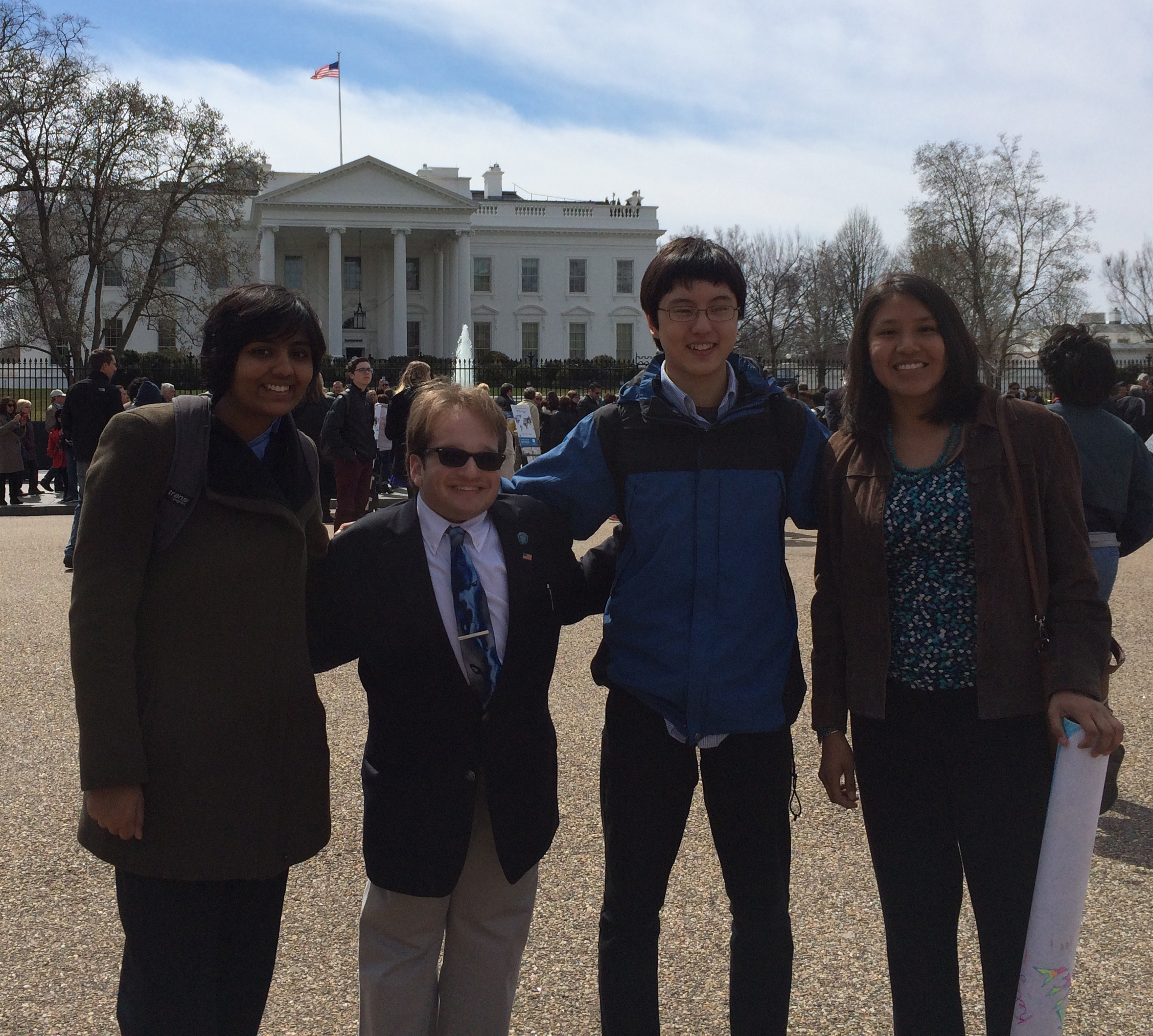 Anvita Gupta, Harry Paul. Nathan Han, and Kelly Charley in front of the White House.
