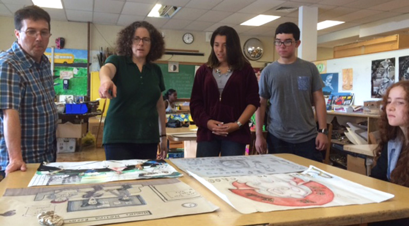 "Social studies and art students created posters based on six most common U.S. History and government essay topics to help special education students ""see the essays"" during review."
