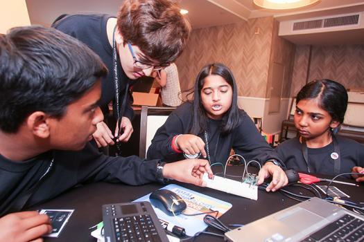Ananya (middle) and her teammates work on a Raspberry Pi challenge.