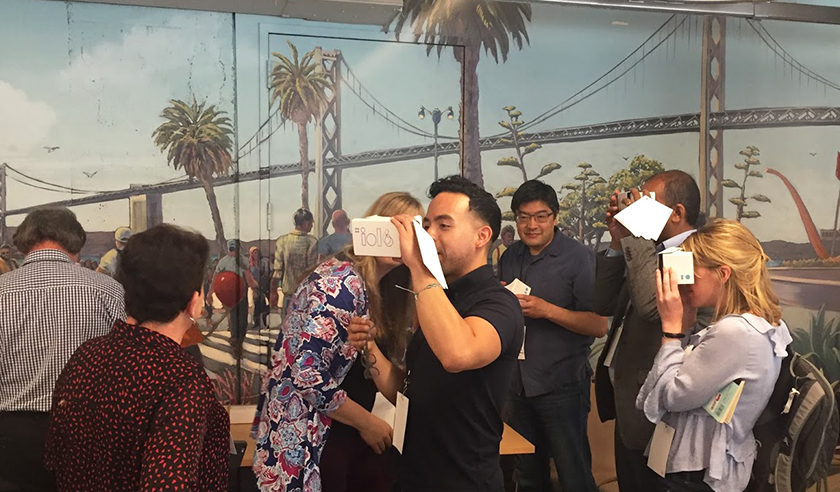 Attendees at the June 4 Upswell Labs event try virtual reality headsets at one of the demonstrations.