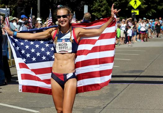 Maria holds up the American flag after winning Olympic Trials this summer.
