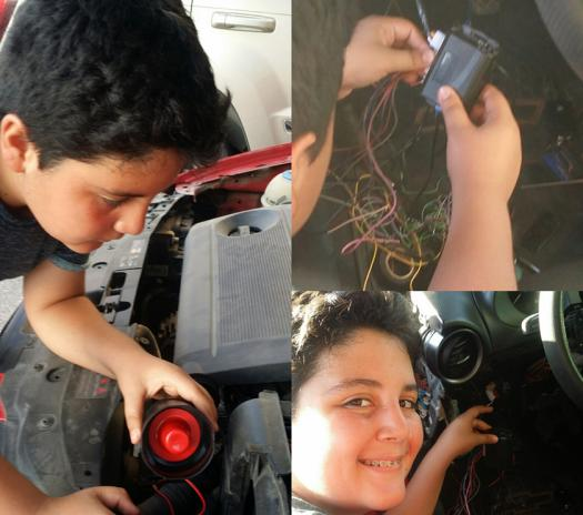 Joaquin attaches his alarm to a car seat.
