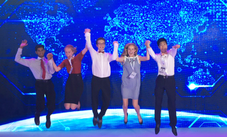Intel ISEF 2017 finalists jump on stage in China during their award trip.