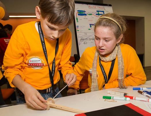 Members of the yellow team work on their robotic crab arm design. ~~ Photo courtesy of Society for Science & the Public/Brady Robinson.