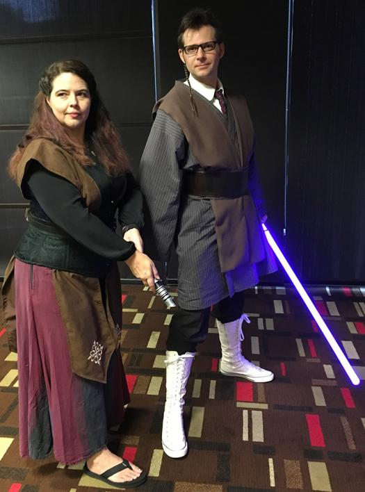 Astronomer Pamela Gay and engineering graduate student Ryan Consell cosplay as Jedis. Ryan is a mashup of Obi Wan and Dr. Who.