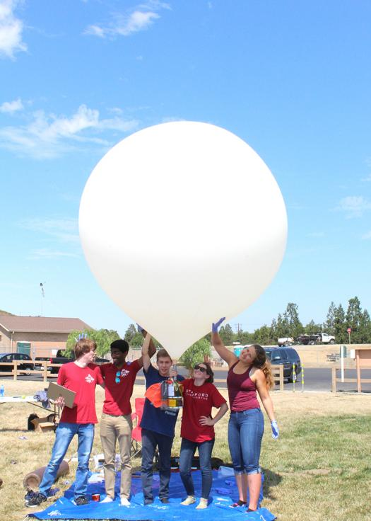 At Stanford, Paige (second from the right) has become the lead mechanical engineer on the Balloons project.