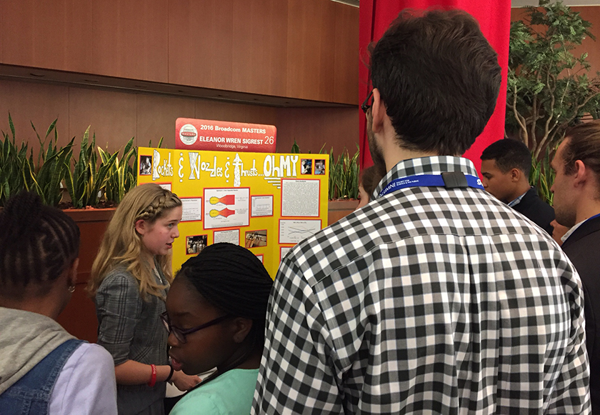 Eleanor Sigrest, from Virginia, explained her project on cold gas rocket nozzles to a large crowd of onlookers.