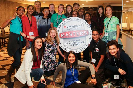 The 2016 finalists hold up the Broadcom MASTERS logo.