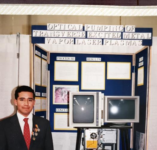 John Taboada Jr. in front of his project board at Intel ISEF 1990