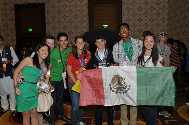 Julie (center) meets students from around the world at the Intel ISEF 2014 Pin Exchange