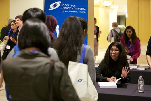 Society alumna Nina Vasan signed copies of her new book, Do Good Well.