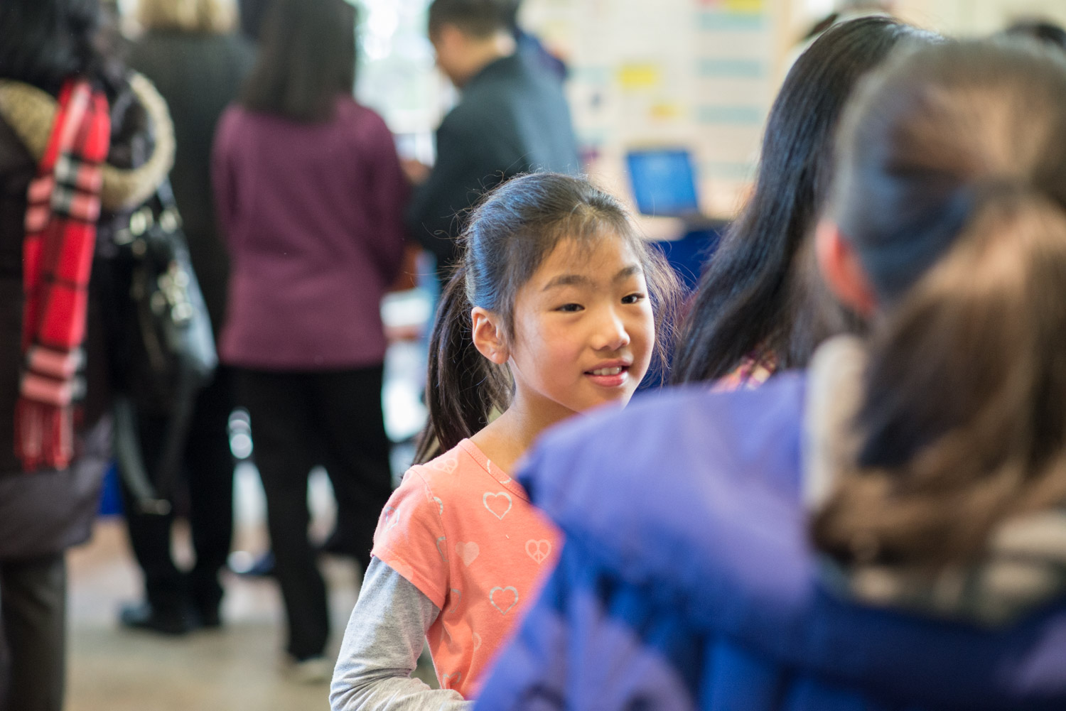 A young science enthusiast learns about a finalist's project.