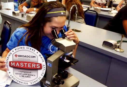 Madison studying a sample of horse blood under a microscope to identify various cells.
