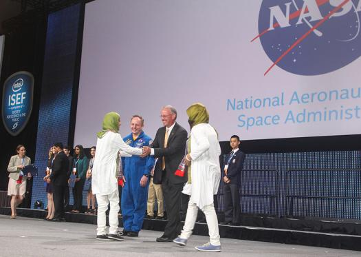 Intel ISEF 2016 finalists receive an award from NASA onstage.