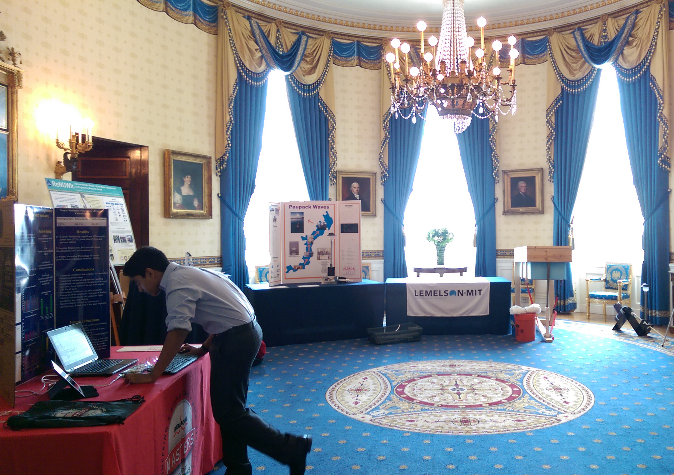 Nikhil Behari, Broadcom MASTERS 2014 finalist, sets up his project in The Blue Room of the White House.