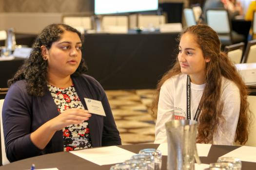 Nikita explains her career path to finalists during a breakout session.