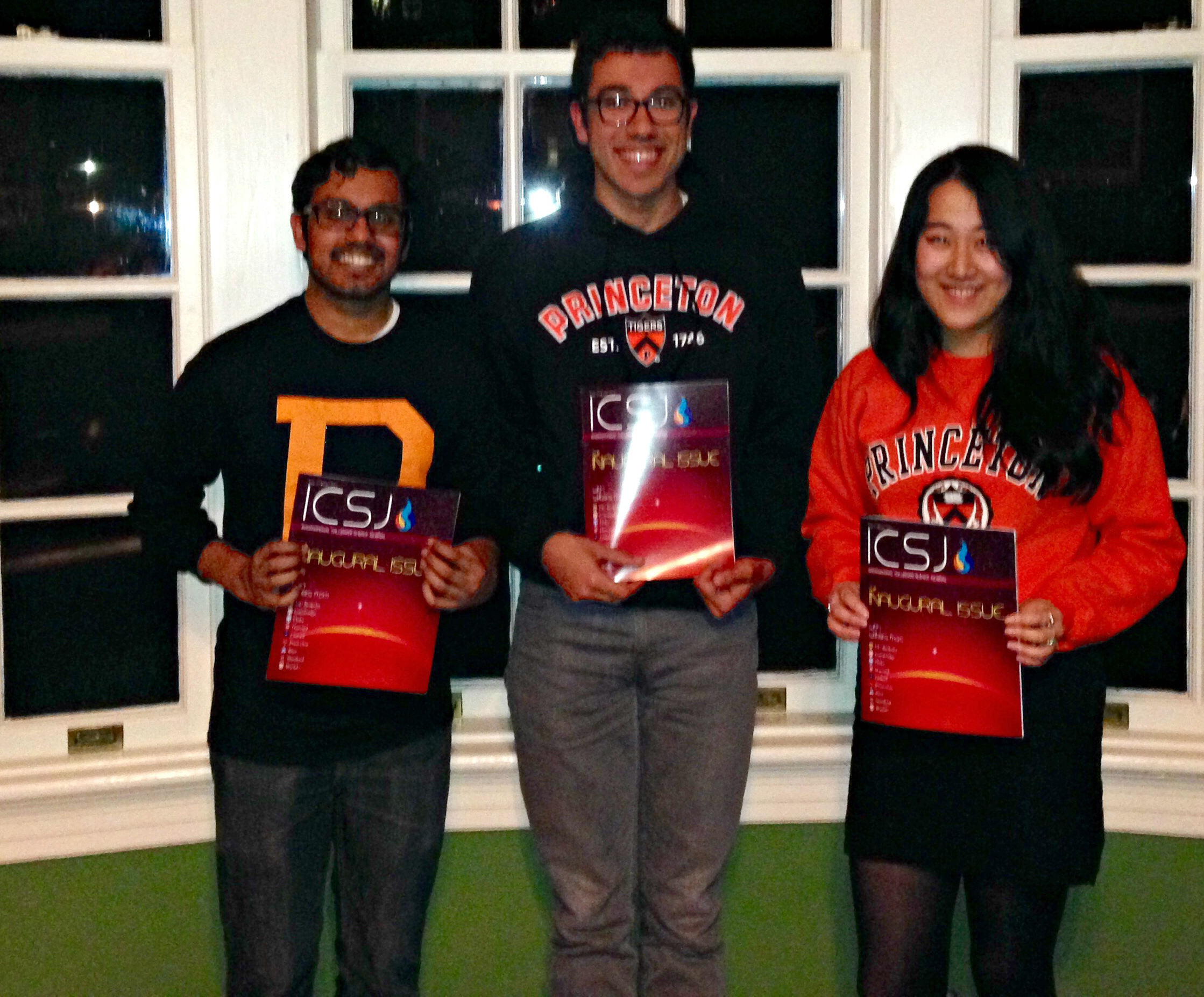 Abrar Choudhury, Stephen Cognetta, and Cissy Chen with their copies of ICSJ at Princeton University
