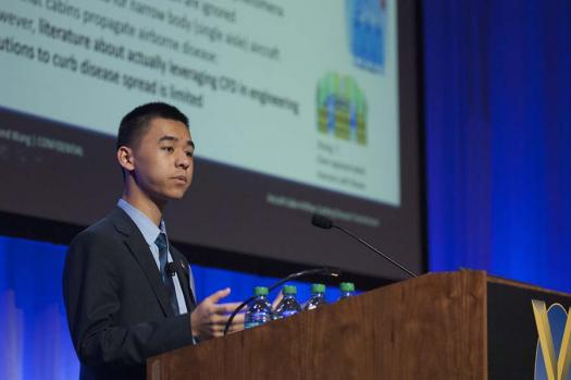 Raymond Wang speaks at the 2015 Society of Experimental Test Pilots symposium. He attended this year's symposium as well.