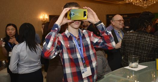 Aaron Yeiser tests a Regeneron virtual reality headset.