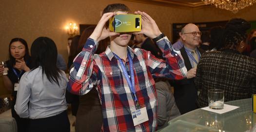 Aaron Yeiser tests a Regeneron virtual reality headset.