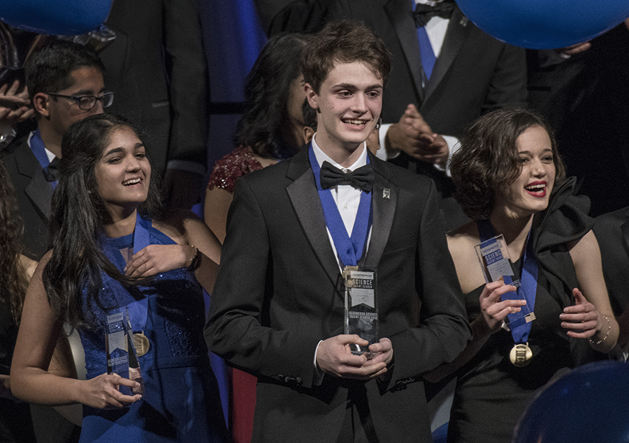 The top three winners of Regeneron STS 2018 on stage at the awards gala.