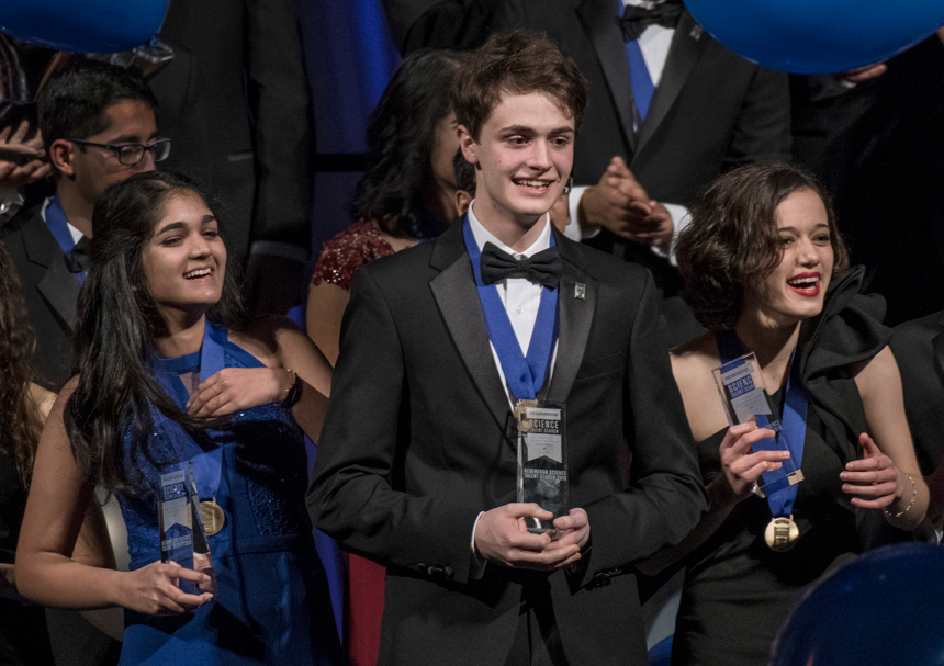 The top three winners on stage at the Regeneron STS 2018 awards gala — Isani Singh (left), Benjamin Firester (middle), and Natalia Orlovsky (right).