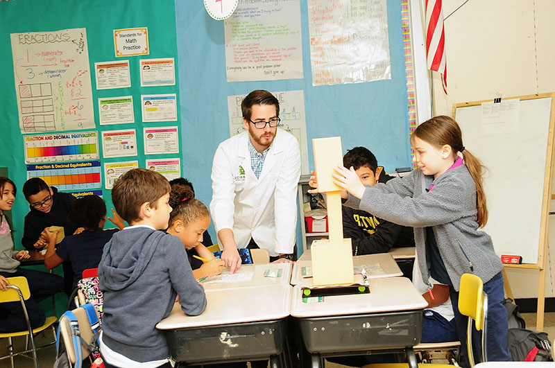 Teacher and students work together on a project from a Science News Educator Guide.