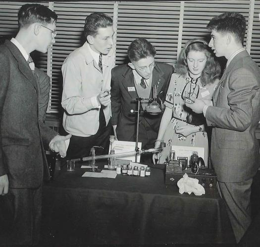 Andrew Sessler (right) and other finalists discuss their hobbies.