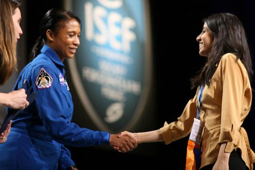 American astronaut Jeanette J. Epps congratulates Naomi as she receives a NASA Special Award at Intel ISEF 2012.