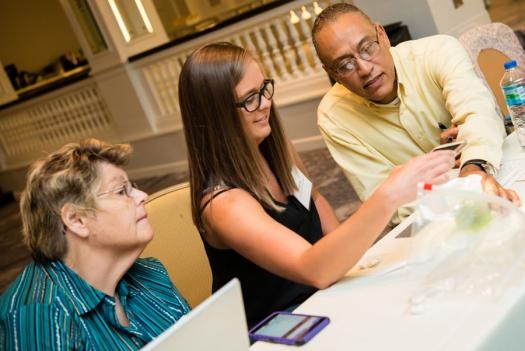From left to right, Marteen Nolen, Shana Lee, and Conrad Faine work on an activity at the Advocate Training Institute.